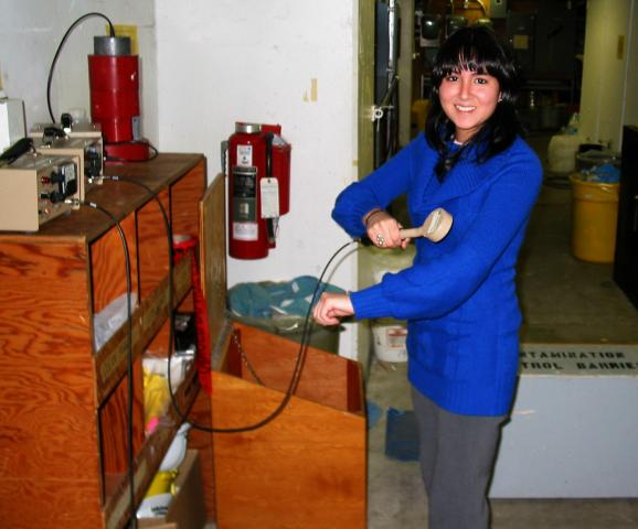 Maria Jose Crousillat using a geiger counter to detect any removable radiation particles